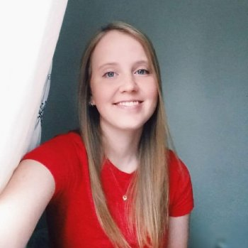 Kimberly Christensen taking a selfie in a bright red t-shirt
