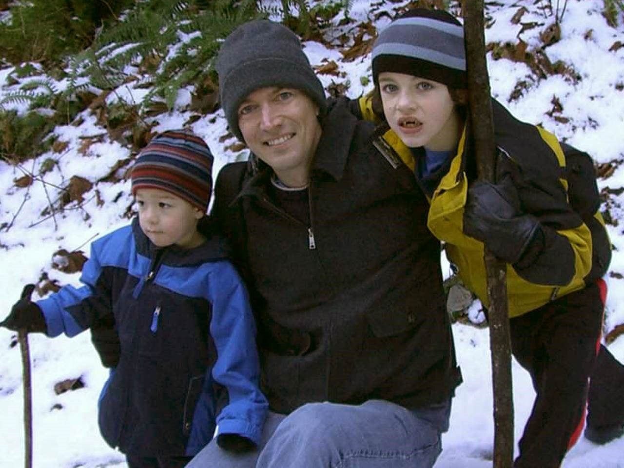 Ethan Remmel with his sons in the snow.