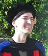 Ethan Remmel in his doctorate graduation regalia